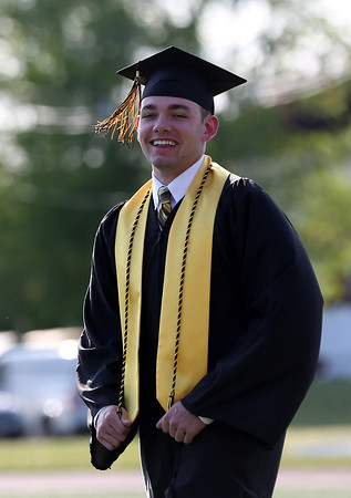 DAVID LE/Staff photo. Bishop Fenwick graduate Bobby Lombardi smiles at family and friends as he proceeds into graduation on Friday evening. 5/20/16.