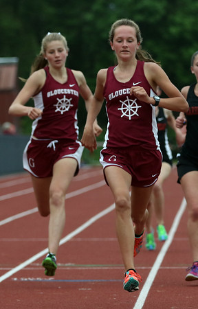 DAVID LE/Staff photo. Gloucester's Eve Feuerbach, right, and Megan Clark, left, took first and second respectively in the girls mile against Marblehead. 5/24/16.