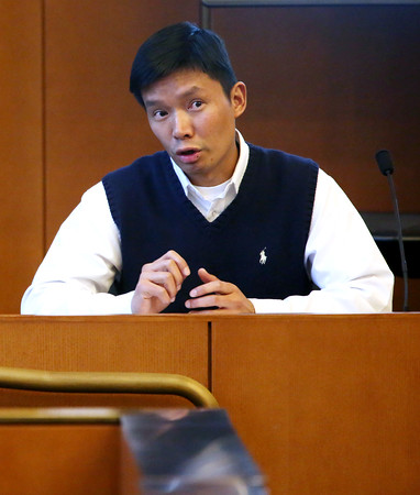 KEN YUSZKUS/Staff photo.    Sifa Lee answers his attorney's questions while on the stand during his murder case at Salem Superior Court.     05/12/16