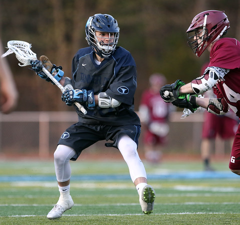 DAVID LE/Staff photo. Peabody senior Cam Cordaro looks to make a play against Gloucester on Thursday evening. 5/12/16.