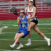 KEN YUSZKUS/Staff photo.   Danvers' Kristen McCarthy, left, has the ball despite the effort of Marblehead's Grace Arthur during the Danvers at Marblehead girls lacrosse game at Marblehead High School.     05/16/16