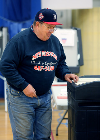 KEN YUSZKUS/Staff photo.     Selectman William Clark places his ballot into the ballot box after voting at Danvers High School.     05/03/16