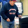 KEN YUSZKUS/Staff photo.     Selectman William Clark places his ballot into the ballot box after voting at Danvers High School.     05/03/16