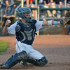 RYAN HUTTON/ Staff photo<br /> Danvers catcher Matt Andreas checks his throw to second base to force the Swampscott runner back to the bag in the top of the fourth inning of Wednesday's game at Danvers.