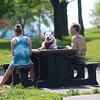 HADLEY GREEN/ Staff photo<br /> Jean Chakoutis and Michael Smith sit with their well-behaved dog, Violet, at the Salem Willows. 5/16/17