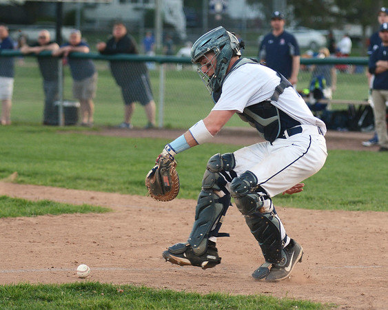 RYAN HUTTON/ Staff photo<br /> Danvers' Matt Andreas hounds down a bunt in the top of the fifth inning of Wednesday's home game against Swampscott.