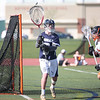 HADLEY GREEN/ Staff photo<br /> Hamilton-Wenham's goalie Mayo Amorello (9) passes the ball at the Beverly v. Hamilton-Wenham boys varsity lacrosse game at Beverly High School. 5/16/17