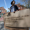 Ken Yuszkus/Staff photo          January O'Neil creates poems on Salem's sidewalks by spraying stencils with a hydrophobic compound that repels water. When it rains, the poems become visible because the letters stay dry. It is part of the Mass. Poetry Festival which runs from May 5 to 7.          5/4/17