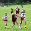 HADLEY GREEN/ Staff photo<br /> Newburyport's Margaret Cote (10) passes the ball while Masconomet's Marina Sheetz (4) and Sarah Richards (14) defend her at the Masconomet v. Newburyport girls varsity lacrosse game at Masconomet High School. 5/23/17