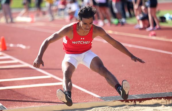 HADLEY GREEN/ Staff photo<br /> Salem's Giovanny Guzman long jumps at the NEC track championships at Peabody High School. 5/20/17