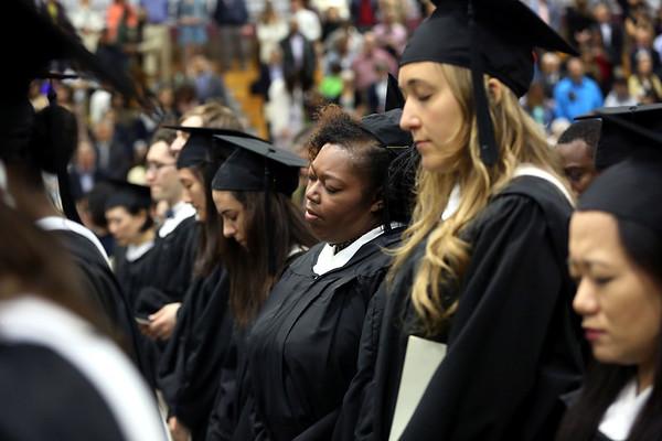 HADLEY GREEN/ Staff photo<br /> Graduates pray during the Gordon-Conwell Theological Seminary graduation ceremony. 5/13/17