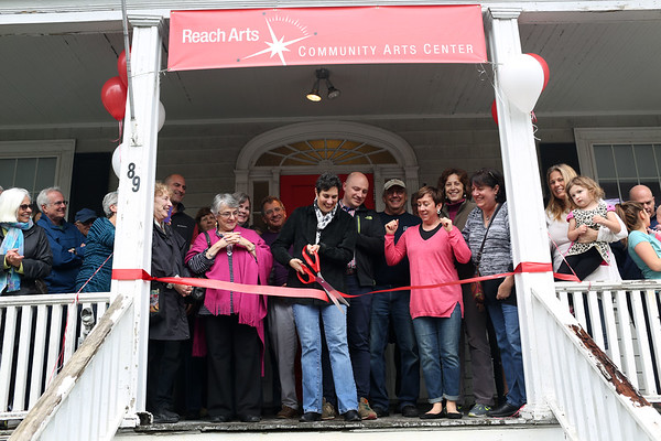 HADLEY GREEN/ Staff photo<br /> Naomi Dreeben, chair of the Swampscott Board of Selectmen, and members of Reach Arts lead the ribbon cutting ceremony at the new cultural arts center on Burrill Street in Swampscott.  5/6/17
