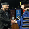 HADLEY GREEN/ Staff photo<br /> Juan Diaz receives his diploma as he shakes hands with President Dr. Patricia Gentile at the North Shore Community College commencement ceremony. 5/24/17