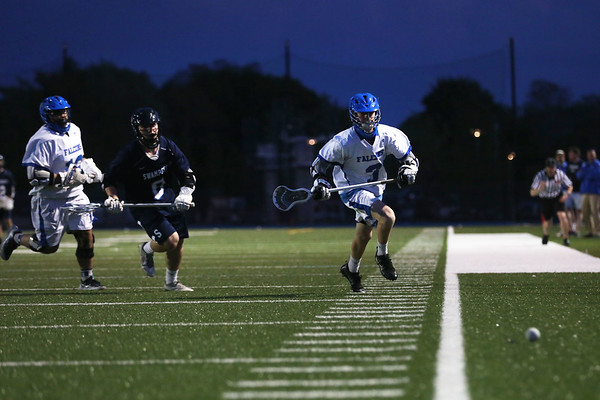 HADLEY GREEN/ Staff photo<br /> Swampscott's Collin Walsh (8) and Danvers' Brendan Treacy (3) chase the ball at the Danvers v. Swampscott boys varsity lacrosse game at Danvers High School. 5/19/17