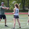 HADLEY GREEN/ Staff photo<br /> Essex Tech coach Matt Gwilliam talks to his team during practice at Essex Technical High School in Danvers. 5/24/17