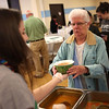 HADLEY GREEN/ Staff photo<br /> Madalaine Quintiliani, a senior at Bishop Fenwick High School, passes Margaret Abbott of Peabody a bowl of pumpkin soup at Haven from Hunger's Empty Bowl Dinner at Peabody High School. The annual community fundraiser supports the hunger-relief organization. 5/4/17