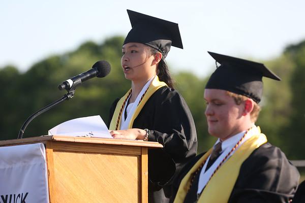 HADLEY GREEN/ Staff photo<br /> Salutatorian Megan Costa addresses her class while standing next to Senior Class President, Garrett Collins, at the Bishop Fenwick High School graduation ceremony. 5/19/17