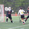 HADLEY GREEN/ Staff photo<br /> Ipswich's goalie Emily Martineau (25) blocks Fenwick's Ally Charette (16) from scoring during the Bishop Fenwick v. Ipswich lacrosse game at Bishop Fenwick High. 5/5/17