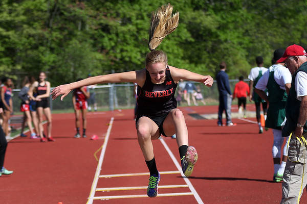 HADLEY GREEN/ Staff photo<br /> Beverly's Annie Towler long jumps at the NEC track championships at Peabody High School. 5/20/17
