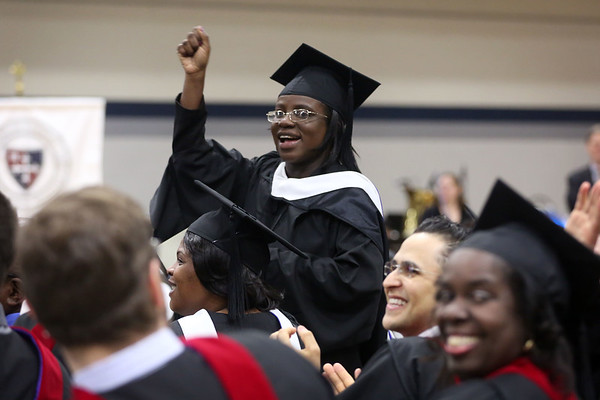 HADLEY GREEN/ Staff photo<br /> Walika Jacques cheers during the Gordon-Conwell Theological Seminary graduation ceremony. 5/13/17