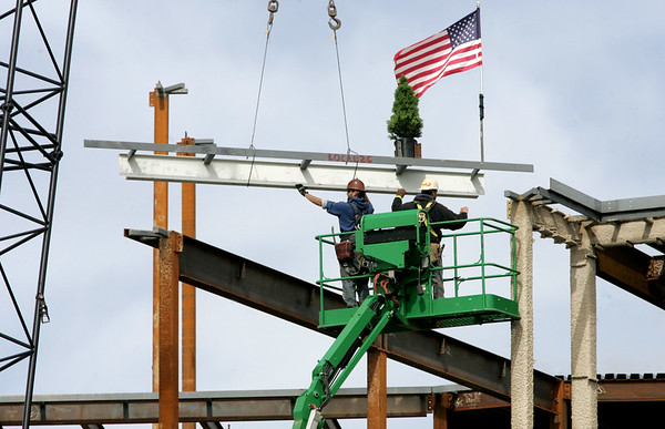Beverly officials raised the last beam to top off the new Beverly Middle School.