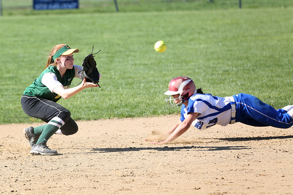 HADLEY GREEN/ Staff photo<br /> Danvers' Erica Haibon (15) slides into second base as Lynn's Rebecca Walker (9) leans to catch the ball at the Danvers v. Lynn Classical High School girls softball game at the Great Oak School in Danvers. 5/10/17