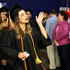 HADLEY GREEN/ Staff photo<br /> Marie Dardonis blows a kiss to her supporters as she walks into Salem State University's commencement for the College of Health and Human Services and Bertolon School of Business. 5/20/17