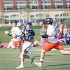 HADLEY GREEN/ Staff photo<br /> Hamilton-Wenham's Bryson Cala (5) passes the ball while Beverly's Kyle Chouinard (2) runs next to him at the Beverly v. Hamilton-Wenham boys varsity lacrosse game at Beverly High School. 5/16/17
