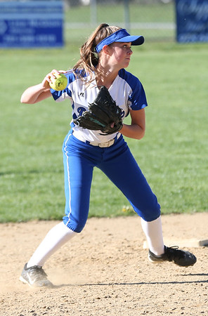 HADLEY GREEN/ Staff photo<br /> Danvers' Julia Boudreau (4) fields the ball and throws it to first base at the Danvers v. Lynn Classical High School girls softball game at the Great Oak School in Danvers. 5/10/17