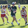 HADLEY GREEN/ Staff photo<br /> Masco's Kaitlyn Waystack (7) picks up the ball while Manchester Essex's Emma Cochand (19) plays defense at the Masco v. Manchester Essex girls varsity lacrosse game held at Masconomet High School. 5/12/17