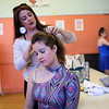 HADLEY GREEN/ Staff photo<br /> Ashley Springett, a dance teacher at Mitchell's Dance Studio, helps put dancer Maggie Skelly's hair in a pony tail before the studio's recital this past Saturday. The Beverly dance studio is celebrating 85 years. 5/20/17