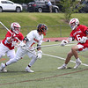 HADLEY GREEN/ Staff photo<br /> Beverly's Sam Abate (5) runs with the ball while Masco's Connor Swarts (13) and Max Sherriff-Streng (6) block him at the Beverly v. Masconomet seventh annual North Shore Cup at Beverly High School. 5/24/17