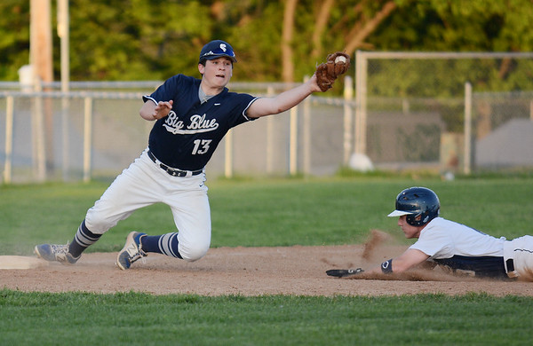 RYAN HUTTON/ Staff photo<br /> Swampscott's Ryan Graciale snags the throw as Danvers' Jordan DeDonato slides into third in the bottom of the fourth inning of Wednesday's game at Danvers.