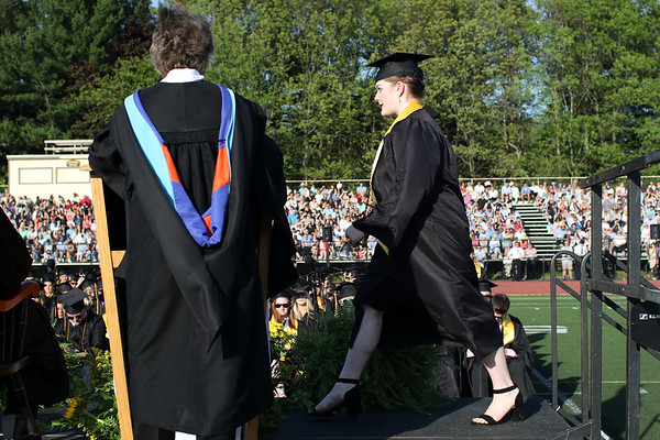 HADLEY GREEN/ Staff photo<br /> Abigayle Harrop walks across the stage to receive her diploma. 5/19/17