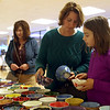 HADLEY GREEN/ Staff photo<br /> Liz Johnson and her daughter Caroline Lapalme pick out their bowls at Haven from Hunger's Empty Bowl Dinner fundraiser at Peabody High School. 5/4/17
