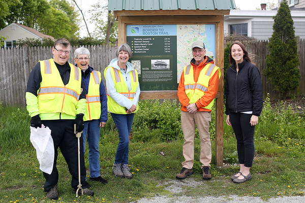 HADLEY GREEN/ Staff photo<br /> From left, bob Brown, Lori DuPont, Nancy McNulty, Paul McNulty, and Georgia Wilson stand next to a sign on the rail trail in Danvers. 5/12/17