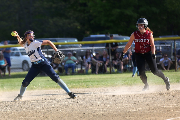 HADLEY GREEN/ Staff photo<br /> Peabody's Mallory LeBlanc (1) throws to first base as Gloucester's Whitney Good (10) rounds second base at the Peabody v. Gloucester girls softball game at the Kiley School field in Peabody. 5/17/17