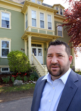 Plummer Youth Promise executive director James Lister stands in front of the building that used to be the Plummer home