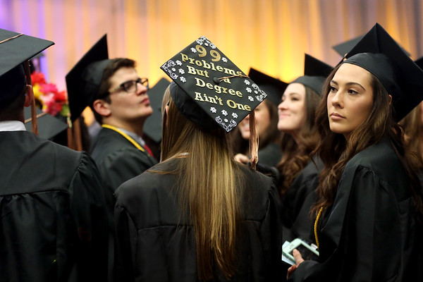 HADLEY GREEN/ Staff photo<br /> Many graduates decorated their caps at Salem State University's commencement for the College of Health and Human Services and Bertolon School of Business. 5/20/17