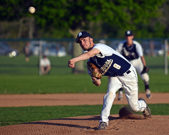 RYAN HUTTON/ Staff photo<br /> Danvers pitcher Justin Nadeau fires one toward the plate in the top of the first inning of Wednesday's home game against Swampscott.