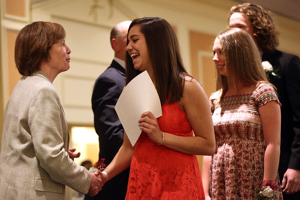 HADLEY GREEN/ Staff photo<br /> Katelyn Moore, a senior at Gloucester High School, shakes Salem State President Patricia Meservey's hand after being recognized at the 49th Annual Honor Scholars Recognition Dinner held at the Doubletree Hotel in Danvers. 5/9/17