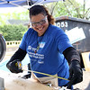 HADLEY GREEN/ Staff photo<br /> Michael Concepcion Velez of Salem measures a piece of wood before sawing. Women volunteered for North Shore Habitat for Humanity to construct two new houses on Asbury street in South Hamilton as part of National Women Build Week. 5/6/17