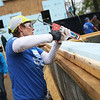HADLEY GREEN/ Staff photo<br /> Ginny Helmar of Beverly uses a caulk gun to glue insulation to a wall board. Helmar is volunteering for North Shore Habitat for Humanity as part of National Women Build Week. 5/6/17