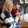 HADLEY GREEN/ Staff photo<br /> Elaine Purdy of Marblehead knits alongside volunteers at Marblehead Knits. 5/4/17