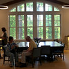HADLEY GREEN/ Staff photo<br /> People sit and stand in the newly renovated Carolyn Holland Hall at the First Church in Wenham. The church held an open house to celebrate their new spaces on Wednesday evening. 5/17/17