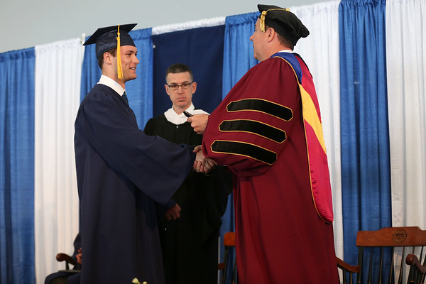 HADLEY GREEN/ Staff photo<br /> Evan Chaisson walks across the stage to receive his diploma at the St. John's Prep commencement ceremony. 5/21/17