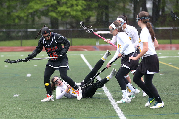 HADLEY GREEN/ Staff photo<br /> Ipswich's Izzy Primack (16) and Fenwick's Cailyn Wesley (10) vie for the ball during the Bishop Fenwick v. Ipswich lacrosse game at Bishop Fenwick High. 5/5/17