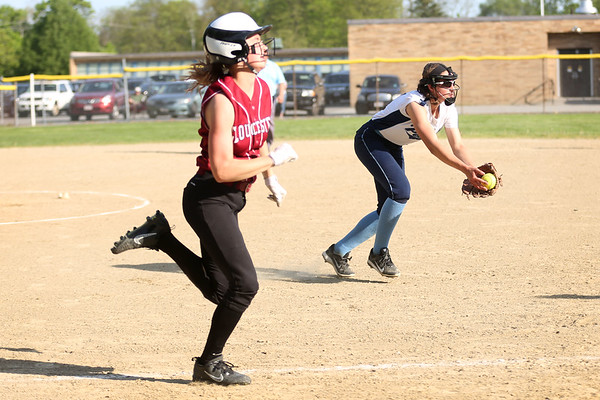 HADLEY GREEN/ Staff photo<br /> Gloucester's Whitney Schrock (3) runs up the line to first base as Peabody's pitcher Tianna Dawe (14) catches the ball at the Peabody v. Gloucester girls softball game at the Kiley School field in Peabody. 5/17/17