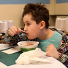 HADLEY GREEN/ Staff photo<br /> Kayden Ordonez, 10, of Lynn, takes a bite of soup at the Empty Bowl Dinner, a fundraising event for Haven from Hunger. Attendees were served soup in hand-painted bowls at Peabody High School. 5/4/17