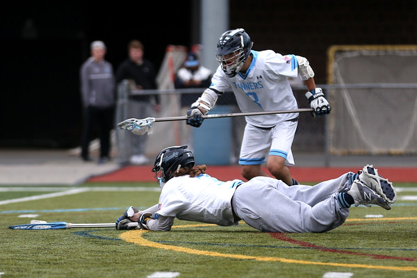 HADLEY GREEN/ Staff photo<br /> Peabody goalie Jake DeStefano (31) dives to make a save while John Najjar (8) stands beside him at the Peabody v. Danvers boys varsity lacrosse game at Peabody Memorial High School. 5/6/17